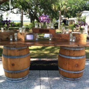 Whiskey Barrels with wood slab top – bar